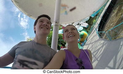 Smiling Couple on the Carousel