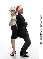 smiling couple posing with santa cap