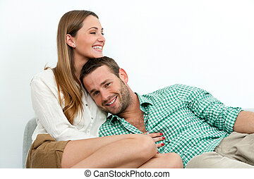 Smiling couple relaxing on couch.
