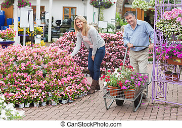 Smiling couple shopping for flowers