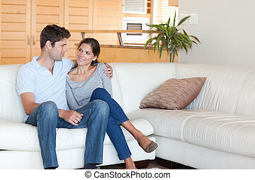 Smiling couple sitting on a couch