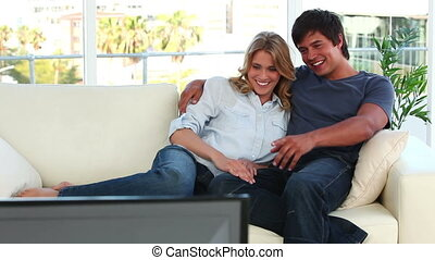 Smiling couple sitting on the sofa