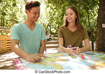 Smiling couple sitting outdoor