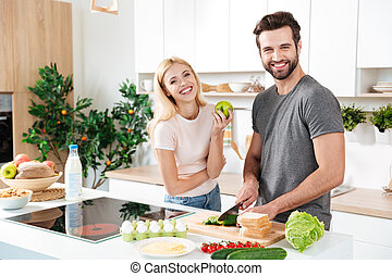 Smiling couple spending time together in the kitchen