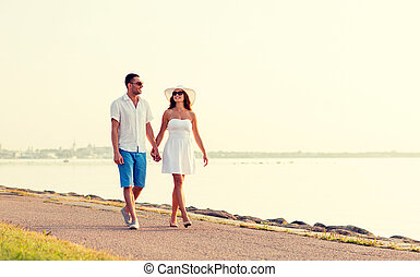 smiling couple walking outdoors