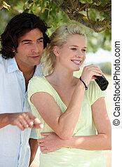 Smiling couple watching through binoculars