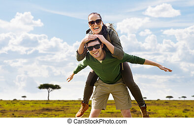 smiling couple with backpacks traveling in africa - travel,...