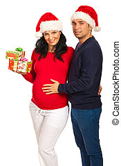 Smiling couple with Christmas gifts