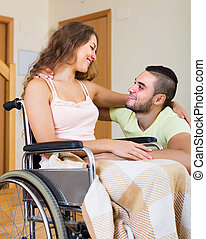 Smiling couple with disabled spouse