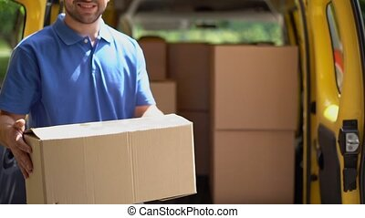 Smiling courier take the package out of van and shows ok sign