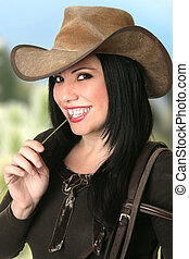 Smiling Cowgirl chewing on lucerne