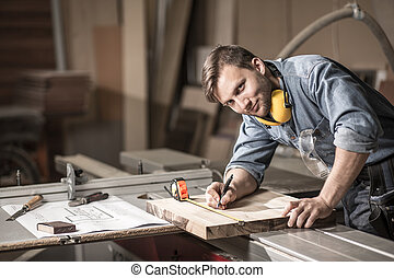 Smiling craftsman during his work - Image of a smiling...