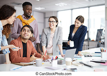 Smiling Creative Team Working in Office