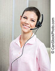 Smiling Customer Service Agent Wearing Headset In Office