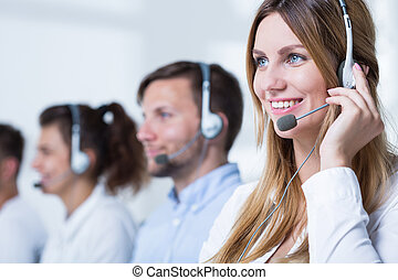 Smiling customer service representative talking with client