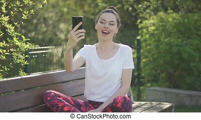 Smiling cute female taking selfie