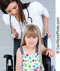 Smiling cute girl sitting on the wheelchair