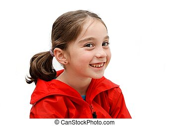 Smiling seven years girl with pigtails isolated