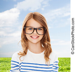 smiling cute little girl with black eyeglasses