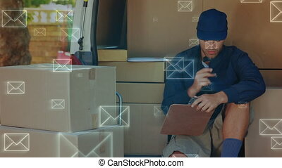 Smiling delivery man counting packages - Digital composite ...