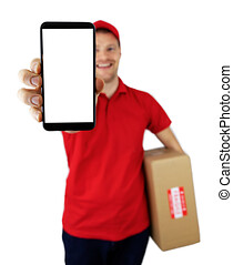 smiling delivery man showing smartphone with blank screen