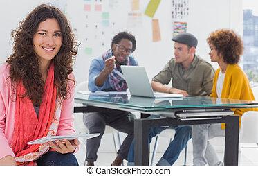 Smiling designer using tablet