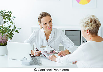 Smiling dietitian holding diet plan