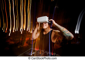 Smiling DJ in virtual reality glasses plays the track in club