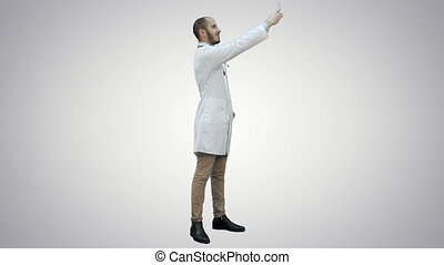 Smiling doctor in white coat taking selfie on his phone on white background.