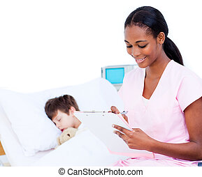 Smiling doctor making notes on a patient\'s clipboard