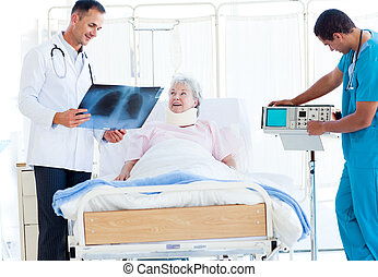 Smiling doctor showing an x-ray to a female patient