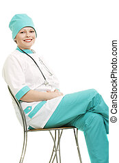 Smiling doctor sitting on chair