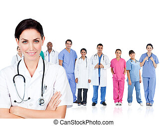 Smiling doctor standing in front of her medical team
