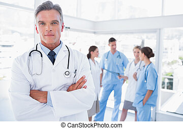 Smiling doctor with arms crossed