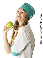 Smiling doctor with green apple