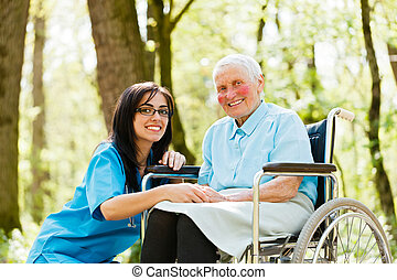 Smiling Doctor with Kind Woman - Kind nurse taking care of...