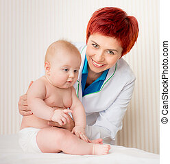 smiling doctor with small baby