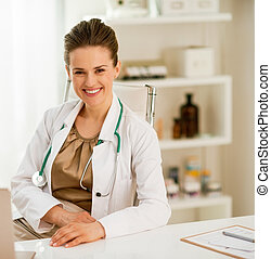 smiling doctor woman in office