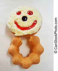 smiling donut with body on white paper background