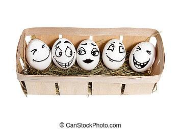 Smiling eggs in basket