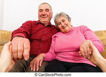 Smiling elderly couple - Photo of happy elderly couple...