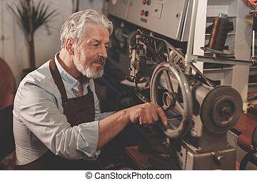Smiling elderly man at work