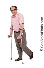 Smiling elderly man with crutches