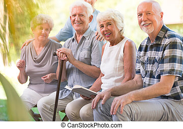 Smiling elderly people at patio