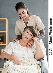 Smiling elderly woman and daughter
