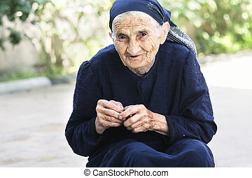 Smiling elderly woman with cherry
