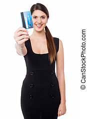 Smiling elegant woman holding credit card - Cheerful young ...