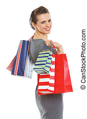 Smiling elegant woman with shopping bags