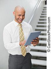 Smiling elegant young businessman