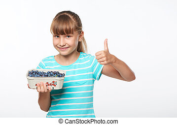Smiling elementary school age girl - Smiling girl holding a ...